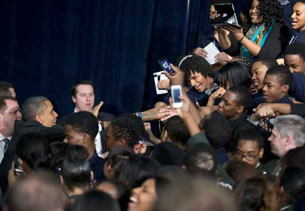 Hyde Park Academy students reach out for President Barack Obama after he spoke on their campus Friday, Feb. 15, 2013, in Chicago. Obama is traveling to promote the economic and educational plan he laid out in his State of the Union address.  &#40;AP Photo&#47;Evan Vucci&#41; <span class=meta>(AP Photo&#47; Evan Vucci)</span>