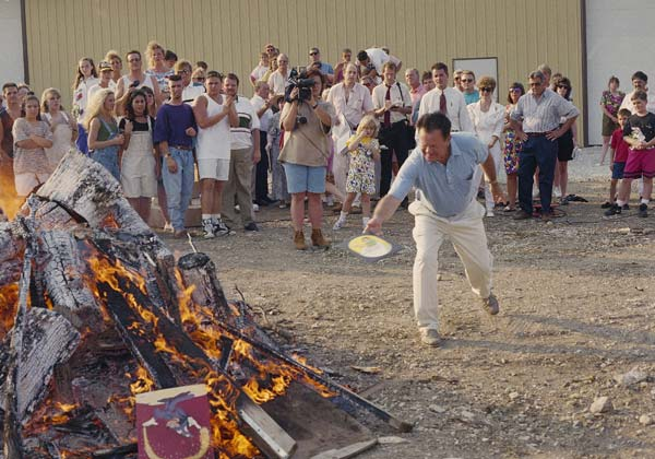Harold Piest, the father of a victim of serial killer John Wayne Gacy, throws a piece of Gacy's artwork on the bonfire at James Quick Auctions Limited, June 18, 1994 in Naperville.  (AP Photo/Frank Polich)