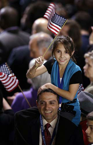 A young supporter waves a flag at the election night party for President Barack Obama Tuesday, Nov. 6, 2012, in Chicago. &#40;AP Photo&#47;Chris Carlson&#41; <span class=meta>(AP Photo&#47; Chris Carlson)</span>