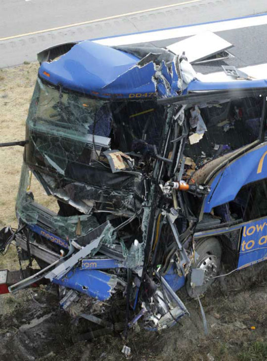 "<div class=""meta ""><span class=""caption-text "">The wreckage of a Megabus is removed from the bridge support pilar that it slammed into after blowing a tire, Thursday, Aug. 2, 2012 in Litchfield, Ill. Illinois State Police Trooper Doug Francis said at least one person was killed in the afternoon wreck which was traveling from Chicago to Kansas City. He didn't immediately have other details about the death. (AP Photo/Tom Gannam) (AP Photo/ Tom Gannam)</span></div>"