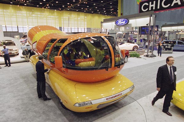 The 1995 Oscar Mayer Wienermobile sits on the floor of the Chicago Auto Show, Feb. 19, 1995 in Chicago.   (AP Photo/Charles Bennett)