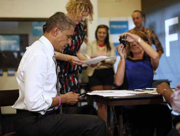 President Barack Obama dials a phone number as he makes calls at a local campaign office during an unscheduled stop, Thursday, Oct. 25, 2012, in Chicago. The president flew to Chicago to cast his vote, during early voting, in the 2012 election. &#40;AP Photo&#47;Pablo Martinez Monsivais&#41; <span class=meta>(AP Photo&#47; Pablo Martinez Monsivais)</span>