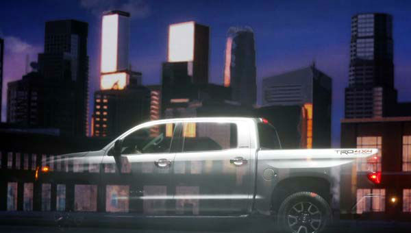 The redesigned 2014 Toyota Tundra is photographed behind a projection screen during its unveiling at the Chicago Auto Show Thursday, Feb. 7, 2013, in Chicago. &#40;AP Photo&#47;Charles Rex Arbogast&#41; <span class=meta>(AP Photo&#47; Charles Rex Arbogast)</span>