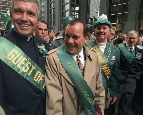 Chicago Mayor Richard Daley, center, leads the city's St. Patrick's Day Parade with Fr. Jack Wall, left, from the old St. Patrick's Church and parade grand marshall William O'Rourke, CEO and president of Coke, Saturday, March 16, 1996, in Chicago.  (AP Photo/Michael S. Green)