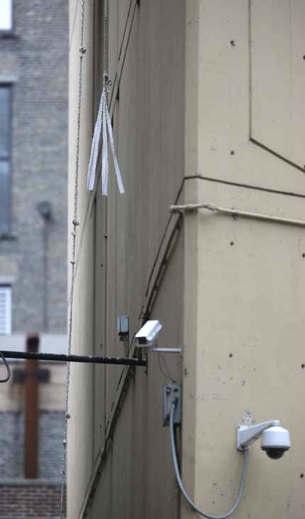 "<div class=""meta image-caption""><div class=""origin-logo origin-image ""><span></span></div><span class=""caption-text"">shreds of cloth hang at the end of a rope that dangles from a window on the back side of the Metropolitan Correctional Center Tuesday, Dec. 18, 2012, in Chicago. Two convicted bank robbers used a knotted rope or bed sheets to escape from the federal prison window high above downtown Chicago early Tuesday, a week after one of them made a courtroom vow of retribution, to federal judge. The escape occurred sometime between 5 a.m. and 8:45 a.m. when the inmates were discovered missing, Chicago Police Sgt. Mark Lazarro said. Hours later, what appeared to be a rope, knotted at six-foot intervals, could be seen dangling into an alley from a window of the Metropolitan Correctional Center approximately 20 stories above the ground. (AP Photo/M. Spencer Green) (AP Photo/ M. Spencer Green)</span></div>"