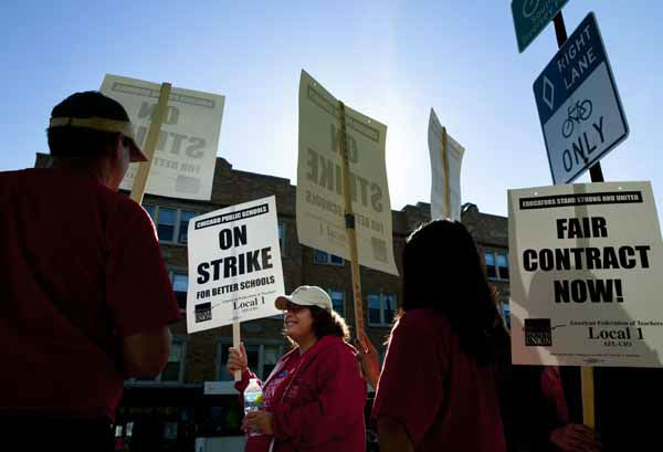 "<div class=""meta ""><span class=""caption-text "">Public school teachers picket outside Amundsen High School on the first day of a strike by the Chicago Teachers Union, Monday, Sept. 10, 2012, in Chicago. The school is one of more than 140 schools in the Chicago Public Schools' ""Children First"" contingency plan, which feeds and houses students for four hours during the strike. (AP Photo/Sitthixay Ditthavong) (AP Photo/ Sitthixay Ditthavong)</span></div>"