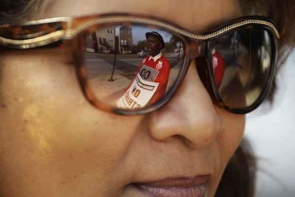 "<div class=""meta ""><span class=""caption-text "">Michael Grant, a parent of a Chicago public school student, is reflected in the glasses of teacher Yasman Vaughn as a handful of teachers picket outside Shoop Elementary School in Chicago, Monday, Sept. 17, 2012, as a strike by Chicago Teachers Union members heads into its second week. Mayor Rahm Emanuel said he will seek a court order to force the city's teachers back into the classroom. (AP Photo/M. Spencer Green) (AP Photo/ M. Spencer Green)</span></div>"