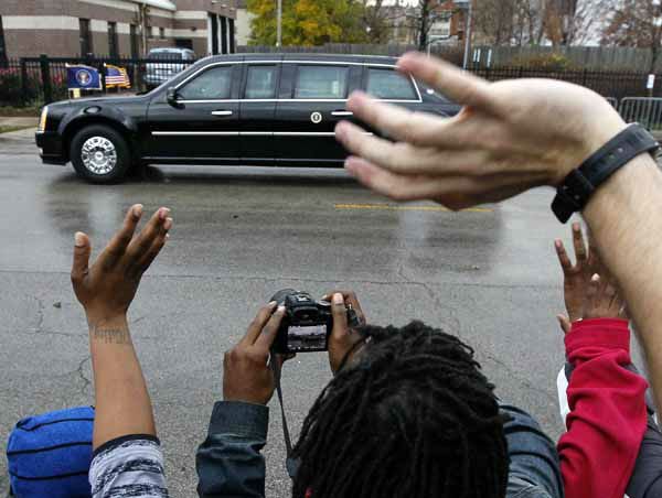Residents of Chicago&#39;s Bronzeville neighborhood wave at President Obama after he voted early at the Martin Luther King Community Center in the South side neighborhood, Thursday, Oct. 25, 2012. &#40;AP Photo&#47;Charles Rex Arbogast&#41; <span class=meta>(AP Photo&#47; Charles Rex Arbogast)</span>
