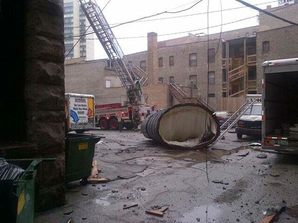 Three people were injured- one critically- when a water tower fell from the top of a building in the 2800-block of North Pine Grove Ave. in Chicago&#39;s Lakeview neighborhood on the city&#39;s North Side.  <span class=meta>(Photo&#47;Chicago Fire Department Media)</span>