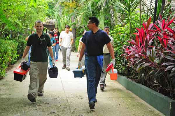 "<div class=""meta ""><span class=""caption-text "">Dr. Michael Adkesson (left) and Dr. Carlos Sanchez, associate veterinarians for the Chicago Zoological Society?s Brookfield Zoo, carrying medical supplies prior to performing root canal on Tantor, a 47-year-old African bush elephant at Barranquilla Zoo in Colombia. (Photo/Barranquilla Zoo)</span></div>"
