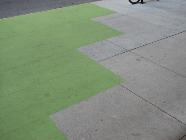 "<div class=""meta ""><span class=""caption-text "">The sidewalk at the Color Jam intersection covered in green vinyl. Photo taken May 29, 2012 (ABC7Chicago.com/ Evan Peterson) (ABC7Chicago.com/ Evan Peterson)</span></div>"