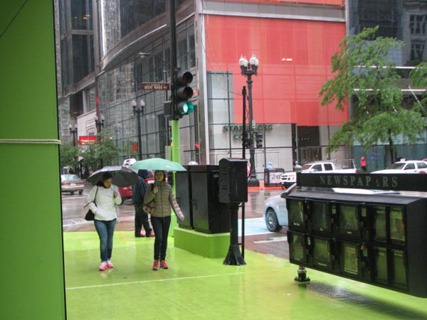 Pedestrians walking on the green sidewalk in the rain at the Color Jam intersection. Photo taken May 31, 2012&#40;ABC7Chicago.com&#47; Evan Peterson&#41; <span class=meta>(ABC7Chicago.com&#47; Evan Peterson)</span>