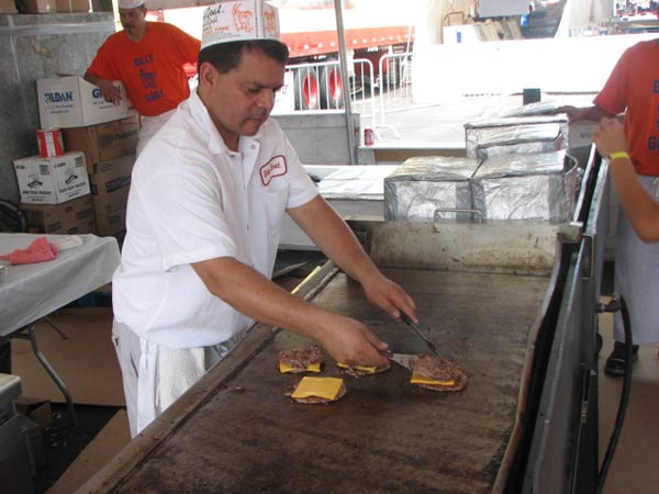"<div class=""meta image-caption""><div class=""origin-logo origin-image ""><span></span></div><span class=""caption-text"">A chef at the Billy Goat Tavern prepares to take a cheese burger of the grill during the 2012 Taste of Chicago on July 12, 2012.   (Evan Peterson/ABC 7 Chicago.com)</span></div>"
