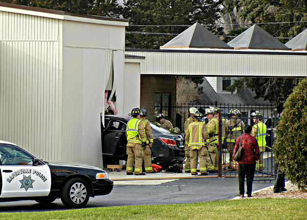 "<div class=""meta ""><span class=""caption-text "">Naperville firefighters respond around 1 p.m. Friday, Nov. 30, 2012, to a vehicle that crashed into the wall of a business at Rosin Eye Car, 705 East Ogden Ave., Naperville, IL.  