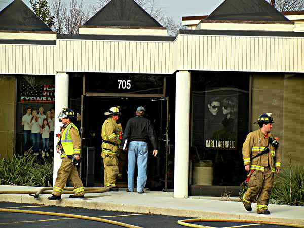 "<div class=""meta image-caption""><div class=""origin-logo origin-image ""><span></span></div><span class=""caption-text"">Naperville firefighters respond around 1 p.m. Friday, Nov. 30, 2012, to a vehicle that crashed into the wall of a business at Rosin Eye Car, 705 East Ogden Ave., Naperville, IL.  