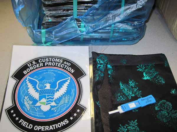 "<div class=""meta image-caption""><div class=""origin-logo origin-image ""><span></span></div><span class=""caption-text"">""On March 18, at 5:30 p.m., CBP canine Shadow alerted to a parcel shipped from Laos. The contents of the parcel were undeclared and found to contain 10 individual pieces of cloth wrapped in plastic. CBP officers tested the cloths resulting in a positive reaction for opium. The ten pieces of opium saturated cloths had a combined weight of 4.84 pounds, valued at $76,707. The shipment was destined for an address in Minnesota."" (Info from US Customs press release) (CBP)</span></div>"