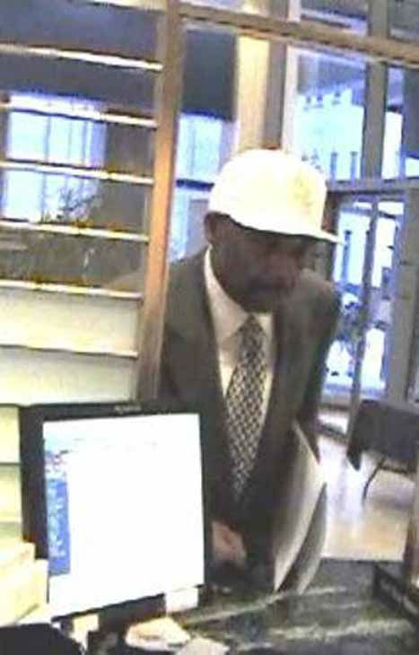 "<div class=""meta ""><span class=""caption-text "">The FBI is looking for help finding the man suspected in four downtown Chicago bank robberies since December 5. The suspect is described as a black male in his 40s, 5'9"" and 5'11"", weighing over 200 pounds.</span></div>"
