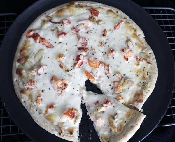 No. 5: Can I get some lobster on the pizza? Not a problem in Boston. Ranked fifth for the best pizza city in the U.S. by  Travel and Leisure.  <span class=meta>([FILE] A freshly-cooked lobster pizza cools on a rack.  &#40;AP Photo&#47;Pat Wellenbach&#41;)</span>