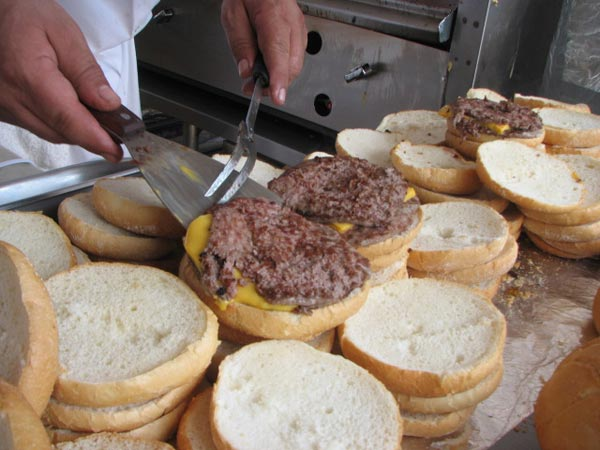 A chef from a popular Chicago restaurant, the Billy Goat Tavern, serves up a cheese burger to hungry customers on July 12, 2012. <span class=meta>(Evan Peterson&#47;ABC 7 Chicago.com)</span>