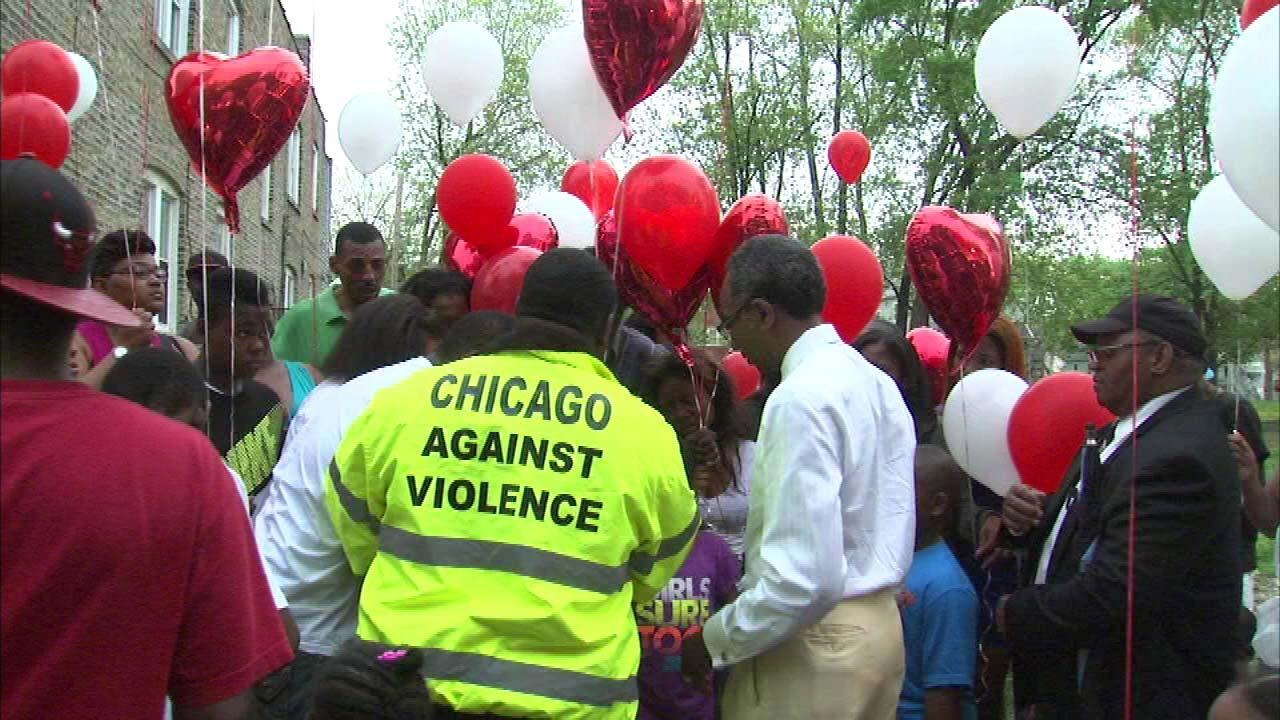 Family and friends gathered on the South Side Sunday evening to hold a vigil for a Chicago mother who was shot and killed.