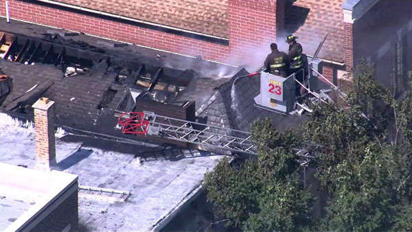 "<div class=""meta ""><span class=""caption-text "">Crews were called to the 3600-block of North Wayne around 12:45 p.m. Tuesday. The fire spread to a neighboring building before it was struck.  (WLS Photo)</span></div>"