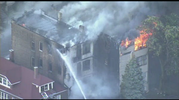 Firefighters fought flames at an apartment in Chicago's Little Village neighborhood, Tuesday, July 17, 2012. Chopper 7 HD was over the on the 4100-block of West 21st Place.
