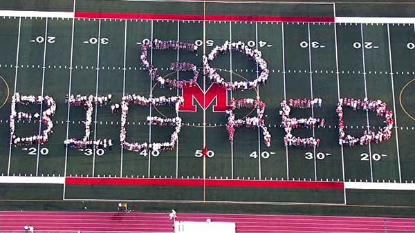 "<div class=""meta ""><span class=""caption-text "">Mundelein High School</span></div>"