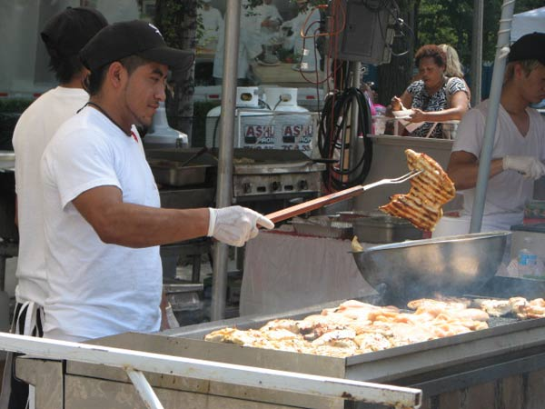 "<div class=""meta ""><span class=""caption-text "">Samual Jualss, chef at the Star of Siam booth, grills chicken for Taste goers on July 12, 2012.   (Evan Peterson/ABC 7 Chicago.com)</span></div>"
