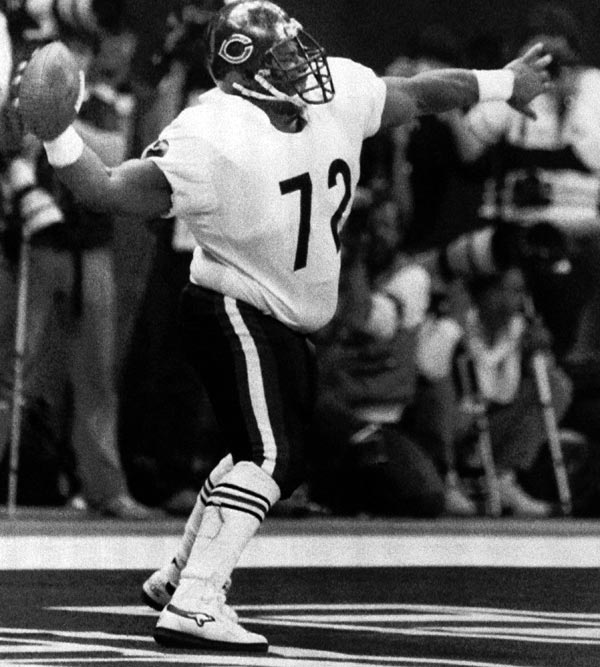 Chicago Bears William Perry spikes the ball after scoring a touchdown on Jan. 26, 1986 at Super Bowl XX in New Orleans. The Bears beat the New England Patriots 46-10 and scored most points in Super Bowl history. (AP Photo)