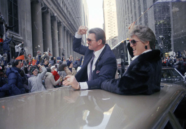 Chicago Bears coach Mike Ditka and his wife, Diana, get cheers from the crowd as they ride in a limousine during a tickertape parade for the team in downtown Chicago, Jan. 27, 1986. More than 100,000 people braved the near-zero temperature to see the team celebrate the Super Bowl victory. (AP Photo/Mark Elias)