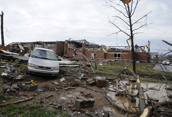 Debris litters the front of the Henryville Middle School which received extensive damage from storms that rolled through the area Friday, March 2, 2012, in Henryville, Ind. Tornadoes ripped across several small southern Indiana towns on Friday, killing at least three people and leaving behind miles of flattened devastation along the border with Kentucky. (AP Photo/Timothy D. Easley)