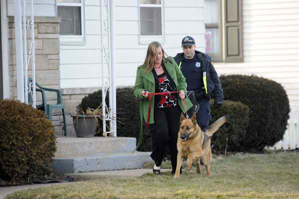 South Bend police remove a resident from her home near the scene of a plane crash near the South Bend Regional Airport Sunday March 17, 2013 in South Bend, Ind. The private jet apparently experiencing mechanical trouble crashed Sunday in a northern Indiana neighborhood, resulting in injuries and striking three homes, authorities and witnesses said.  &#40;AP Photo&#47;Joe Raymond&#41; <span class=meta>(AP Photo&#47; Joe Raymond)</span>