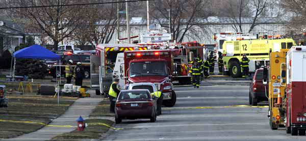 "<div class=""meta ""><span class=""caption-text "">South Bend police and fire officials examine the scene of a plane crash near the South Bend Regional Airport Sunday March 17, 2013 in South Bend, Ind. The private jet apparently experiencing mechanical trouble crashed in a northern Indiana neighborhood, resulting in injuries and striking three homes, authorities and witnesses said. (AP Photo/Joe Raymond) (AP Photo/ Joe Raymond)</span></div>"