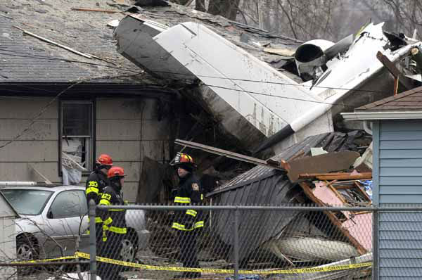 South Bend firefighters work at the scene, Monday, March 18, 2013, where a plane crashed on Sunday, near the South Bend Regional Airport, in South Bend, Ind. The plane damaged homes, as well as causing injuries. &#40;AP Photo&#47;Joe Raymond&#41; <span class=meta>(AP Photo&#47; Joe Raymond)</span>