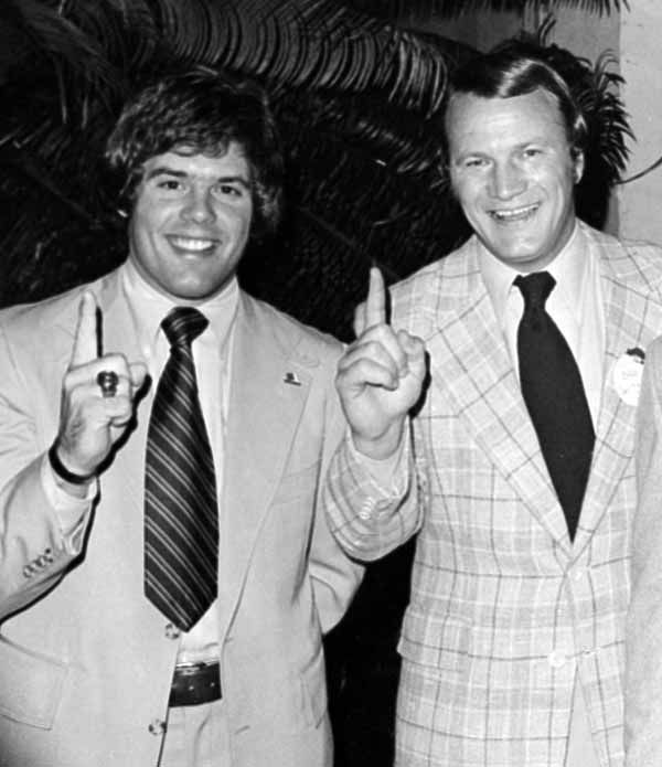 FILE - In this Jan. 2, 1976 file photo, University of Oklahoma football coach Barry Switzer, right, and quarterback Steven Davis, give the &#34;number one&#34; sign in Miami Beach, after the Associated Press named the Sooners as the national champions for the second year in a row. A University of Oklahoma official says the starting quarterback for Oklahoma&#39;s national championship teams in 1974 and 1975 is one of two men killed when a small plane slammed into a house in northern Indiana. St. Joseph County Coroner Randy Magdalinski identified the victims of Sunday&#39;s March 17, 2013 crash as 60-year-old Steven Davis and 58-year-old Wesley Caves, both of Tulsa, Okla.  &#40;AP Photo, File&#41; <span class=meta>(AP Photo&#47; Anonymous)</span>