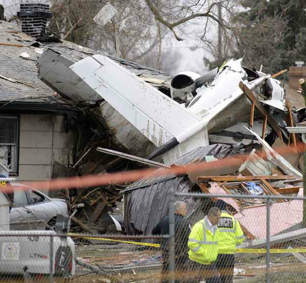 South Bend firefighters work a home, Monday, March 18, 2013, in South Bend, Ind., where a plane crashed Sunday. The plane damaged homes, as well as caused injuries, including at least two fatalities. &#40;AP Photo&#47;Joe Raymond&#41; <span class=meta>(AP Photo&#47; Joe Raymond)</span>
