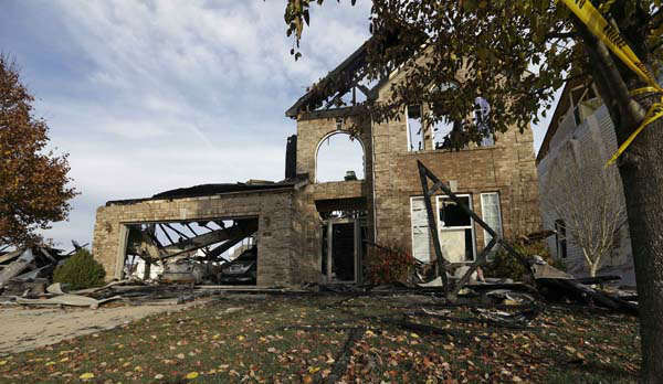 "<div class=""meta ""><span class=""caption-text "">Two cars sit in a home that was heavily damaged by a explosion  Sunday, Nov. 11, 2012, in Indianapolis. Nearly three dozen homes were damaged or destroyed, and seven people were taken to a hospital with injuries, authorities said Sunday. The powerful nighttime blast shattered windows, crumpled walls and could be felt at least three miles away. (AP Photo/Darron Cummings) (AP Photo/ Darron Cummings)</span></div>"