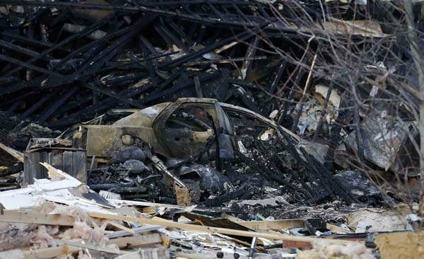 "<div class=""meta ""><span class=""caption-text "">A burned car sits in a pile of debris at the site of a home explosion, Sunday, Nov. 11, 2012, in Indianapolis. Nearly three dozen homes were damaged or destroyed, and seven people were taken to a hospital with injuries, authorities said Sunday. The powerful nighttime blast shattered windows, crumpled walls and could be felt at least three miles away. (AP Photo/Darron Cummings) (AP Photo/ Darron Cummings)</span></div>"