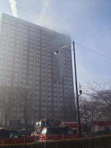 The fire was contained to a 9-floor unit in the 20-floor high-rise at 1633 West Madison known as the Patrick Sullivan Apartments.  <span class=meta>(WLS Photo)</span>