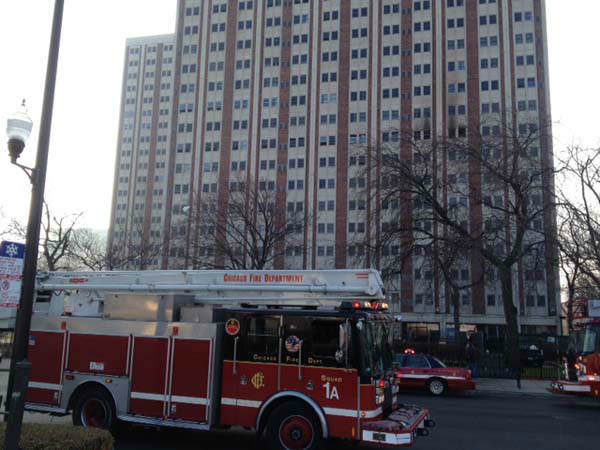 "<div class=""meta ""><span class=""caption-text "">The fire was contained to a 9-floor unit in the 20-floor high-rise at 1633 West Madison known as the Patrick Sullivan Apartments.  (WLS Photo)</span></div>"