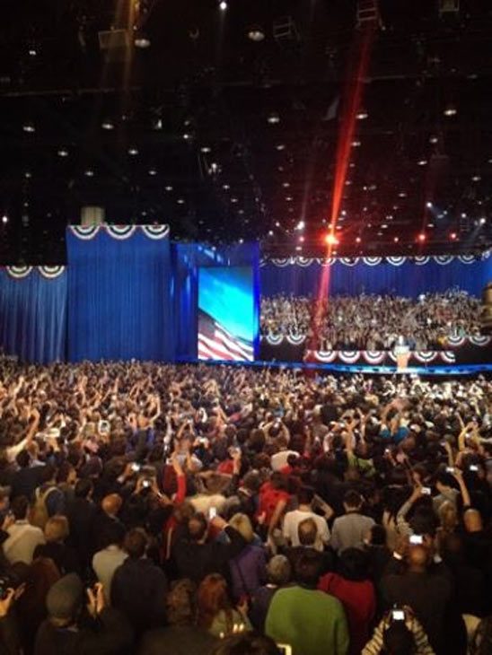 McCormick Place crowd watches President Obama on stage, Wednesday morning, Nov. 7, 2012.