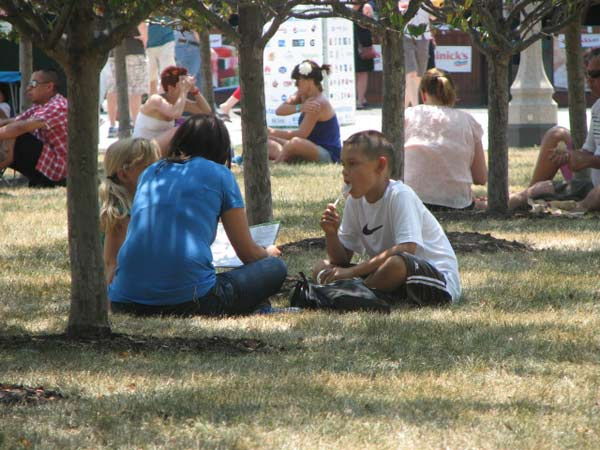 Nadine McDaniel, a first time Taste of Chicago visitor, takes a break in the shade with her two children on July 12, 2012.    <span class=meta>(Evan Peterson&#47;ABC 7 Chicago.com)</span>