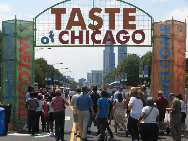 This year&#39;s Taste of Chicago sign will see millions of people pass under it and into Grant Park. The world&#39;s largest food festival opened its doors on July 11 and will keep them open until July 15.Taste goers can anticipate chowing down on popular Chicago restaurants who serve  bite size samples from their menu, and live musical performances from bands such as Death Cab for Cutie, Michael Franti &amp; Spearhead, Chaka Khan and many more. <span class=meta>(Evan Peterson&#47;ABC 7 Chicago.com)</span>