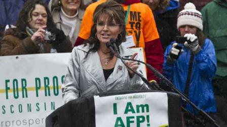 Former Alaska Gov. Sarah Palin speaks at a tax day tea party rally Saturday, April 16, 2011, in Madison, Wis.