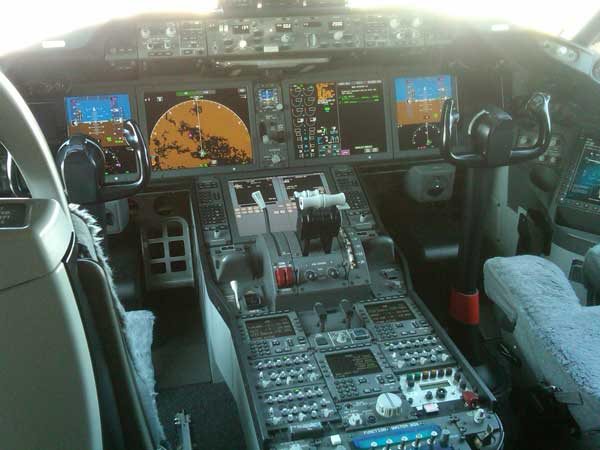 The cockpit features customized wide screen displays <span class=meta>(ABC7&#39;s Ben Bradley)</span>