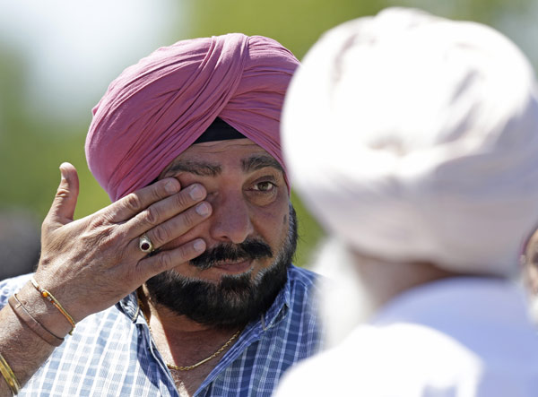 "<div class=""meta ""><span class=""caption-text "">A man wipes away tears outside the Sikh Temple in Oak Creek, Wis. where a shooting took place on Sunday, Aug 5, 2012. (AP Photo/Jeffrey Phelps)</span></div>"