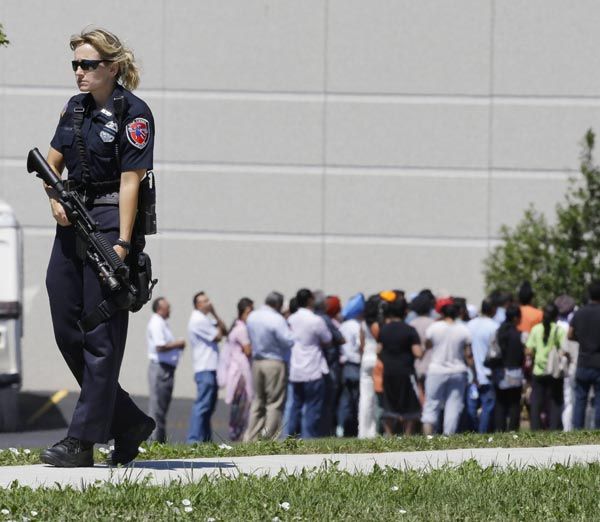 "<div class=""meta ""><span class=""caption-text "">Police stand guard as bystanders watch at the scene of a shooting inside a Sikh temple in Oak Creek, Wis., Sunday, Aug. 5, 2012. Police and witnesses describe a chaotic situation with an unknown number of victims, suspects and possible hostages. (AP Photo/Jeffrey Phelps)</span></div>"
