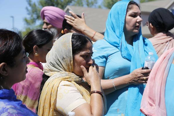 "<div class=""meta ""><span class=""caption-text "">Bystanders stand outside the scene of a shooting inside The Sikh Temple in Oak Creek, Wis, Sunday, Aug. 5, 2012. Police in Wisconsin say at least seven people are dead at a Sikh temple near Milwaukee, including the suspected gunman. (AP Photo/Jeffrey Phelps)</span></div>"