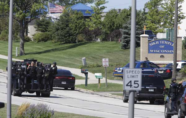 "<div class=""meta ""><span class=""caption-text "">Police personnel move outside the Sikh Temple in Oak Creek, Wis., where a shooting took place Sunday, Aug 5, 2012. (AP Photo/Jeffrey Phelps)</span></div>"