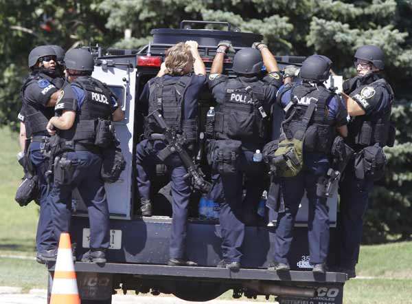 "<div class=""meta ""><span class=""caption-text "">Police personnel move outside the Sikh Temple in Oak Creek, Wis, where a shooting took place Sunday, Aug. 5, 2012. (AP Photo/Jeffrey Phelps)</span></div>"